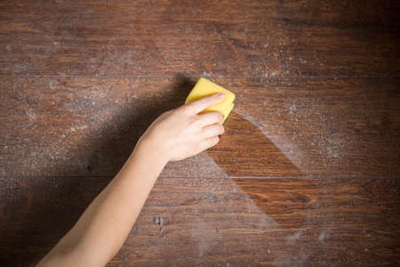 Photo pour Cleaning dust from the wood in house - image libre de droit