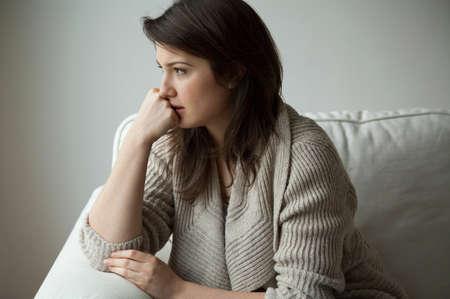 Foto de Portrait of melancholy women sitting alone - Imagen libre de derechos