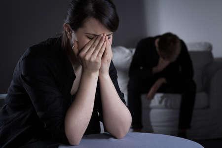 Foto de Photo of prostrate crying woman and man - Imagen libre de derechos