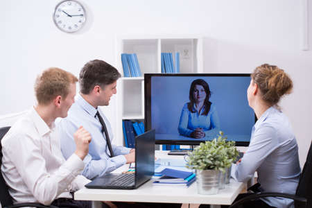 Photo pour Modern office - business team having web conference - image libre de droit