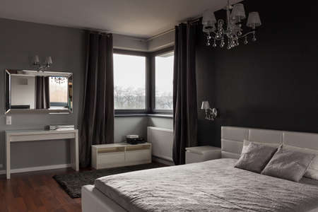 Foto de Dark expensive bedroom with black and grey walls - Imagen libre de derechos