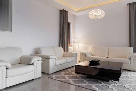 Foto de Contemporary cozy family room with three comfortable sofas - Imagen libre de derechos