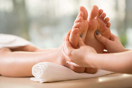 Photo for Close-up of young woman having reflexology - Royalty Free Image