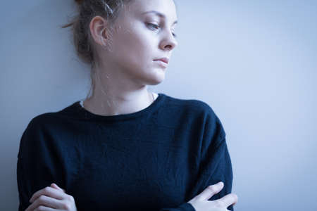 Photo pour Portrait of sad woman in black sweater - image libre de droit