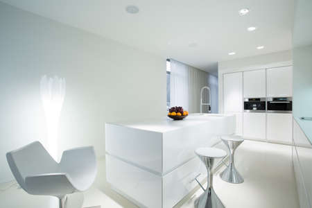Modern white kitchen with extravagant dining space