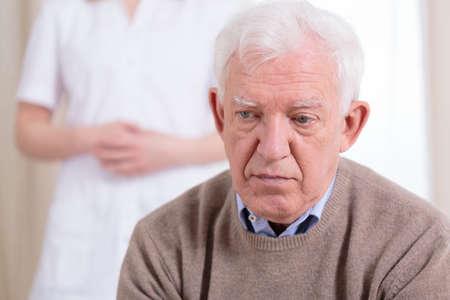 Photo pour Sad older lonely man sitting at nursing home - image libre de droit