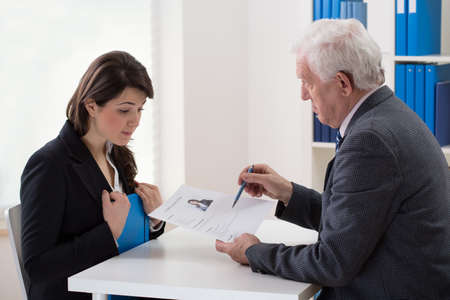 Photo for Young woman talking with an older man about a potential job - Royalty Free Image