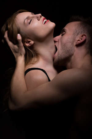 Photo for Hot foreplay - passionate man biting woman's neck - Royalty Free Image
