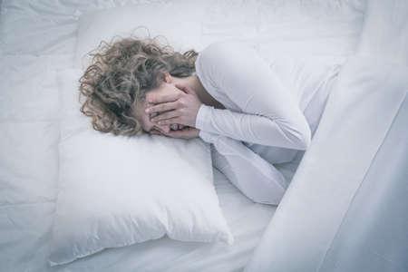 Foto de Picture of depressed woman sleeping all day - Imagen libre de derechos
