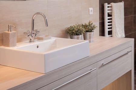 Foto de Close-up of white porcelain square basin in new bathroom - Imagen libre de derechos