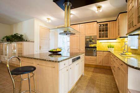 Photo pour Close-up of kitchen island in designed kitchen - image libre de droit