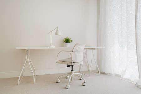 Photo for White retro desk in pure empty interior - Royalty Free Image