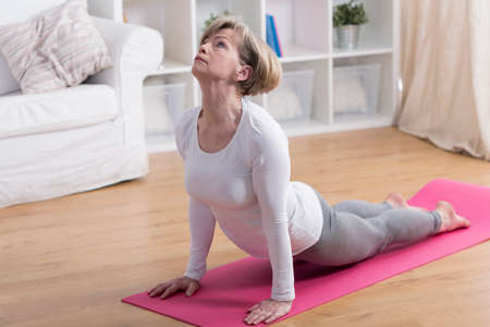 Foto per Older active woman exercising yoga in the morning - Immagine Royalty Free