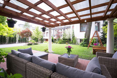 Photo for Designed modern arbour with comfortable garden furniture - Royalty Free Image
