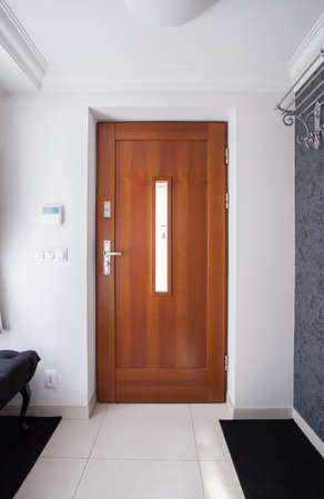 Foto de Wooden front door in luxury detached house - Imagen libre de derechos