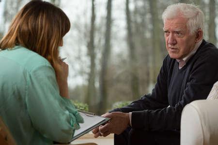 Photo pour Image of young psychiatrist and her elder patient - image libre de droit