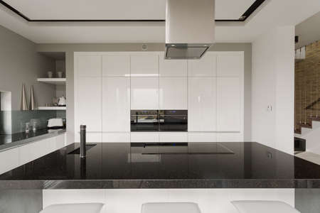 Photo pour Picture of black and white kitchen interior - image libre de droit