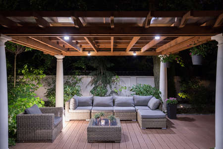 Photo pour Picture of arbour with comfortable garden furniture - image libre de droit
