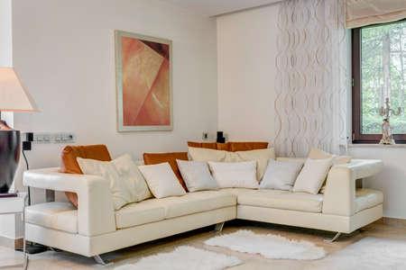 Photo pour Cream corner sofa in luxury living room - image libre de droit