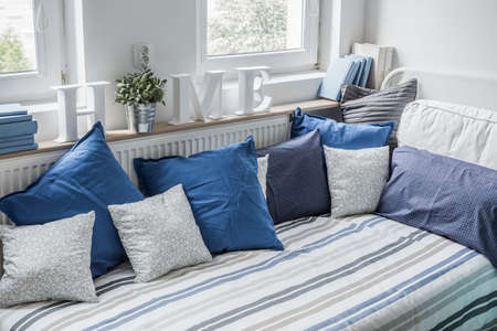 Photo for White and blue bedding set on the bed - Royalty Free Image
