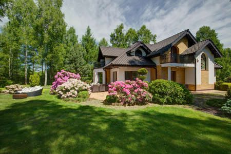 Photo for Exterior of detached house with beauty garden - Royalty Free Image