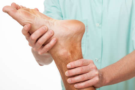 Photo pour Patient after stroke doing foot exercise during physiotherapy - image libre de droit