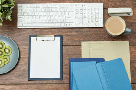 Photo for Clipboard and books on wooden office desk - Royalty Free Image