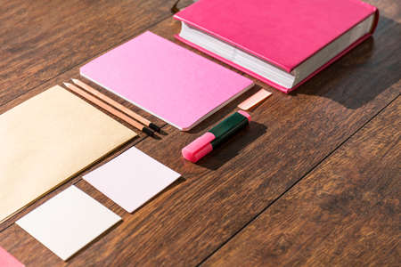 Photo for Pink tools prepared on wooden desk office for paperwork - Royalty Free Image