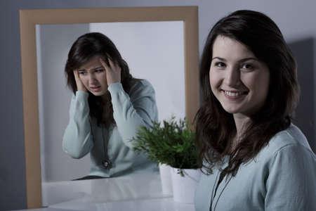 Photo pour Smiling pretty young girl with bipolar disorder - image libre de droit