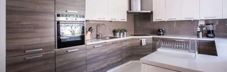 Photo pour Close-up of wooden cupboards in cozy kitchen - image libre de droit