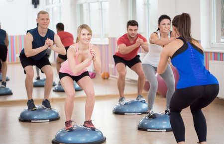 Photo pour Group of people during balance training, horizontal - image libre de droit