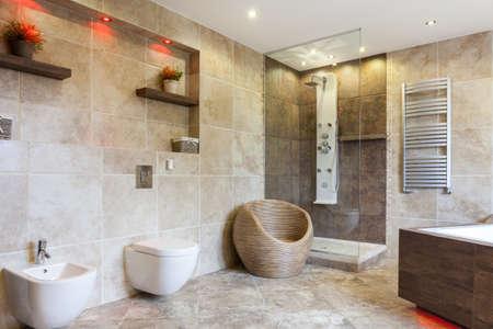 Photo pour Interior of luxury bathroom with beige tiles - image libre de droit