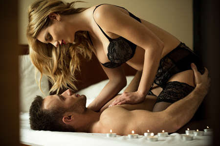 Photo pour Loving couple having intimate moments in bedroom - image libre de droit