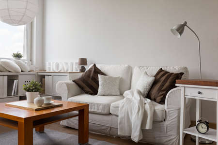 Photo for Small cozy living room in white flat - Royalty Free Image