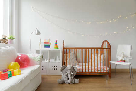 Photo pour Photo of white and cosy newborn room interior - image libre de droit