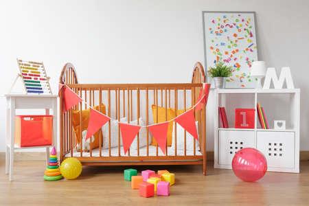 Photo pour Picture of bright newborn room interior with colorful toys - image libre de droit