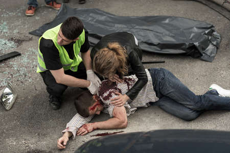 Foto de Corpse of young man lying on the street - Imagen libre de derechos