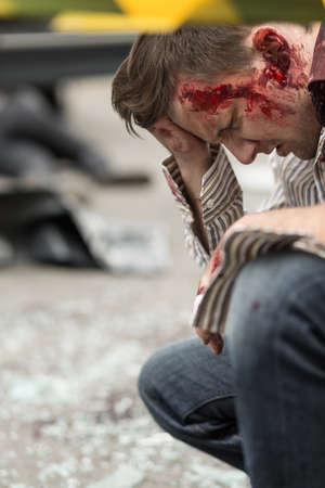 Photo pour Image of bloody man after road accident - image libre de droit