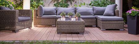Photo pour Set of luxury  wicker furniture in garden patio - image libre de droit
