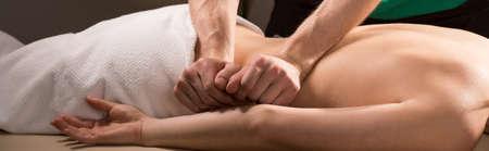 Foto de Panoramic photo of therapeutic back massage treatment - Imagen libre de derechos