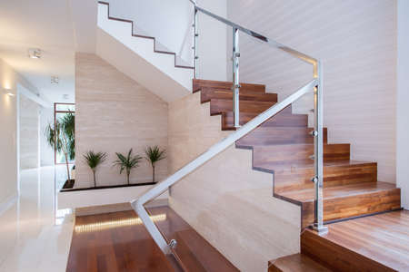 Foto de Image of stylish staircase in bright house interior - Imagen libre de derechos