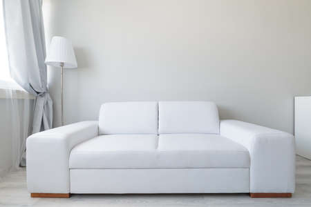 Photo pour Close up of white comfortable leather double sofa - image libre de droit