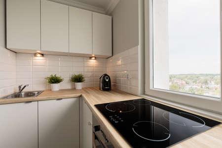 Photo pour Image of functional light kitchen in new flat - image libre de droit