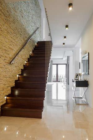 Foto de Classic style hallway with marble floor and wooden stairs - Imagen libre de derechos