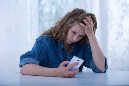 Foto de Image of scared teenager tormented by school bully - Imagen libre de derechos