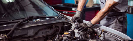 Photo pour Close-up of car mechanic fixing automotive engine - image libre de droit