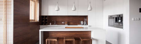 Photo pour Panoramic view of modern style kitchen island in wood kitchen - image libre de droit