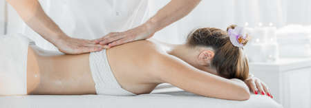 Foto de Panoramic view of woman lying on massage table - Imagen libre de derechos