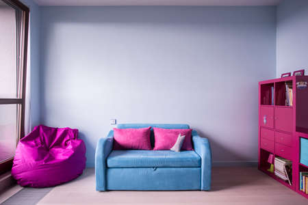 Photo for Blue and rose furniture in girl's room - Royalty Free Image