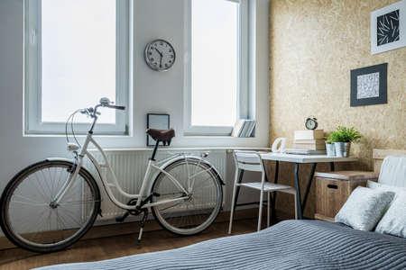 Photo pour Close-up of girl's bike in contemporary bedroom - image libre de droit